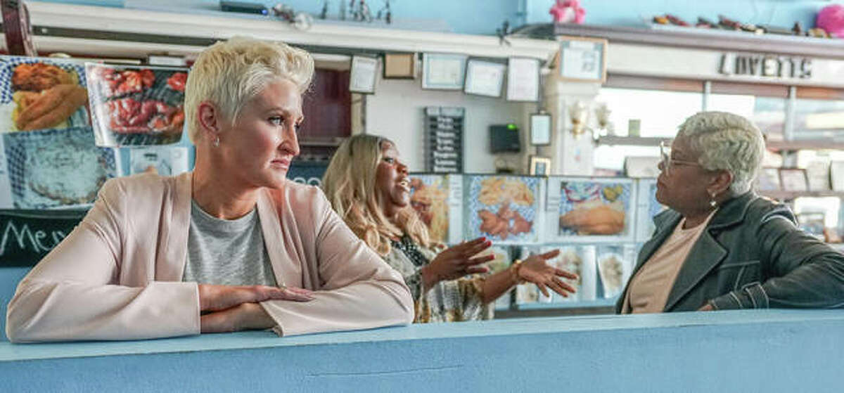 """""""Small Business Revolution - Main Street"""" host Amanda Brinkman pauses during takes Saturday morning, as Lovett's Snoots, Fish, Chicken, & More owner Merry Lovett has a lively conversation with one of the Hulu show's guest experts, Chef Deborah VanTrece."""