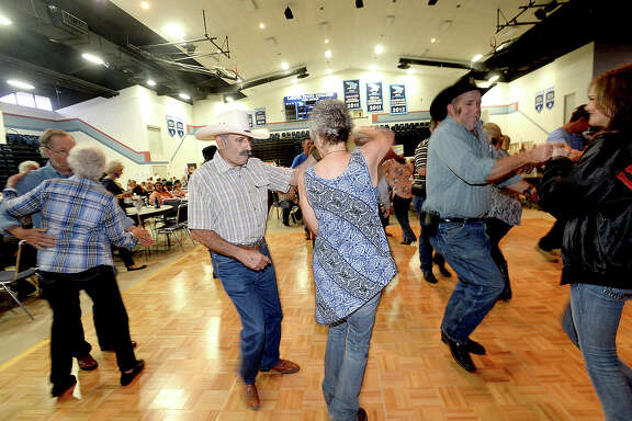 Couples, including Tony Gonzales and Tammy Rains, take to the dance floor as Wayne Toups & Royal BluGarou perform during the Cajun Heritage Festival held at the Carl A. Parker Multipurpose Center in Port Arthur. Plenty of Cajun favorites, including gumbo, boudin, jambalaya and boiled crawfish with sides, were available, and a number of Zydeco and Cajun bands performed.   Photo taken Saturday, April 7, 2018 Kim Brent/The Enterprise