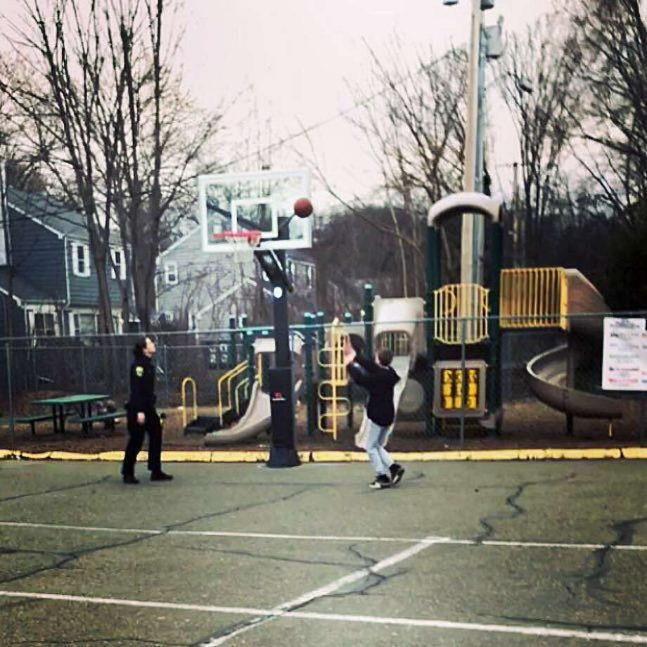 Officer Samantha Salato, of the Fairfield, Conn., police, came across a young man practicing free throws and asked to join him on April 7, 2018. Photo: Contributed Photo / Fairfield Police Department / Contributed Photo / Connecticut Post Contributed