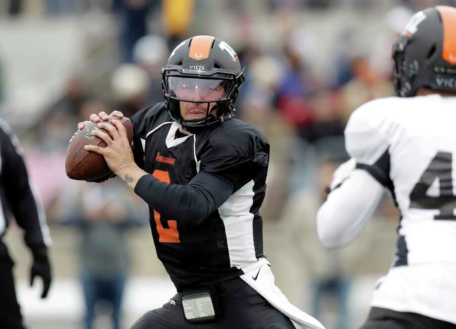 Former Heisman Trophy-winning quarterback Johnny Manziel (2) scrambles as he looks to throw during a developmental Spring League football game, Saturday, April 7, 2018, in Austin, Texas. Manziel is hoping to impress NFL scouts in his bid to return to the league. (AP Photo/Eric Gay) Browse through the photos for a look at Manziel in his first Spring League Game. Photo: Eric Gay, Associated Press / Copyright 2018 The Associated Press. All rights reserved.