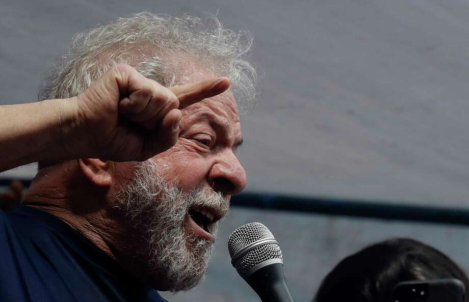 Brazilian former President Luiz Inacio Lula da Silva delivers a speech outside the Metal Workers Union headquarters in Sao Bernardo do Campo, Brazil, Saturday, April 7, 2018. Da Silva told supporters he will comply with an arrest warrant and turn himself in to police, to begin serving a sentence of 12 years and one month for a corruption conviction. (AP Photo/Andre Penner) Photo: Andre Penner / Copyright 2018 The Associated Press. All rights reserved.