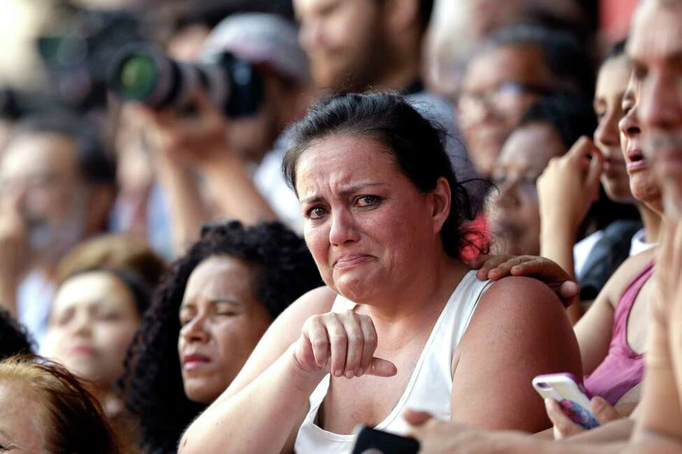 A supporter of Brazilian former President Luiz Inacio Lula da Silva cries as she listens to his speech, outside the Metal Workers Union headquarters in Sao Bernardo do Campo, Brazil, Saturday, April 7, 2018. Da Silva told supporters he will comply with an arrest warrant and turn himself in to police, to begin serving a sentence of 12 years and one month for a corruption conviction. (AP Photo/Andre Penner)