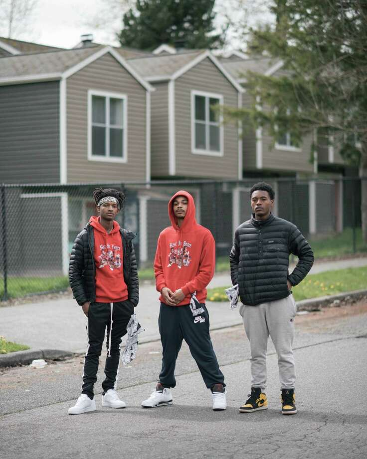 Amir Muhammad, Malachi Cain, and Devin Elliott pose for a portrait outside the home of their best friend, Trevon McKoy, aka JuiceTheGod, in West Seattle on Friday, April 6, 2018. McKoy was killed after a party at Seattle Center on April 1. Photo: GRANT HINDSLEY, SEATTLEPI.COM / SEATTLEPI.COM