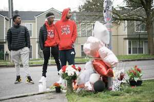 Devin Elliott, Malachi Cain, and Amir Muhammad, visit their best friend Trevon McKoy, aka JuiceTheGod's, memorial in West Seattle on Friday, April 6, 2018. McKoy was killed after a party at the Seattle Center on April 1.