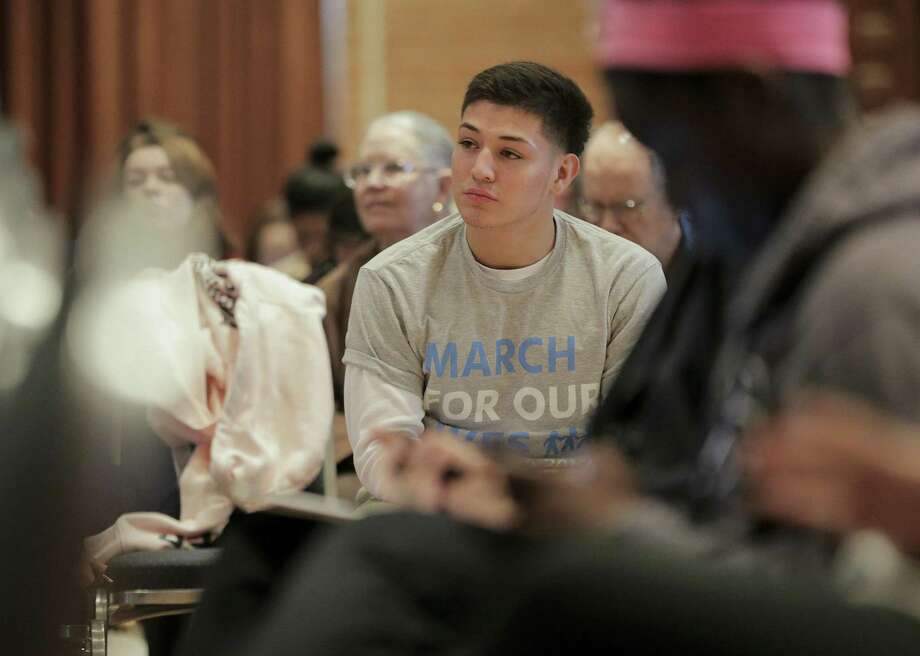 Thomas Rosa listens to Democratic candidates talk Saturday about gun issues at Rice University during an event sponsored by the March For Our Lives organizers. Photo: Elizabeth Conley, Chronicle / Houston Chronicle / © 2018 Houston Chronicle