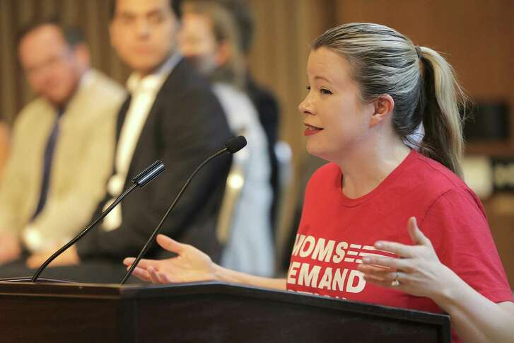 Elizabeth Graham with Mom's Demand Action in Houston, addresses attendees before a candidate forum on gun violence at Rice University sponsored by March For Our Lives on Saturday, April 7, 2018, in Houston. ( Elizabeth Conley / Houston Chronicle )