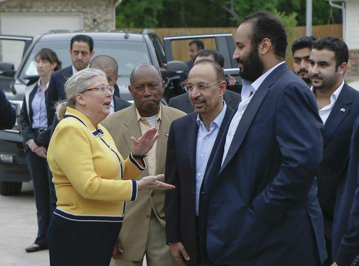 Khalid al-Falih, energy minister (second from right), introduces His Royal Highness Crown Prince Mohammed bin Salman (right) to , Habitat for Humanity Executive Director Allison Hay (left) and Houston Mayor Sylvester Turner at a habitat for humanity home Saturday, April 7, 2018, in Houston. His Royal Highness Crown Prince Mohammed bin Salman visited a habitat for humanity home that aided Harvey victims and was supported by donations by the Aramco, the Saudi oil company. ( Steve Gonzales / Houston Chronicle )