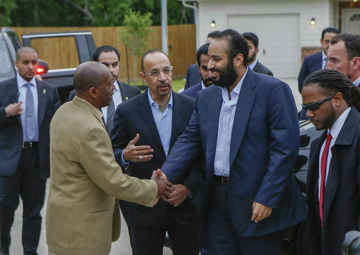 Khalid al-Falih, energy minister (center), introduces The Saudi Crown Prince, His Royal Highness Crown Prince Mohammed bin Salman (right) to Houston Mayor Sylvester Turner at a habitat for humanity home Saturday, April 7, 2018, in Houston. His Royal Highness Crown Prince Mohammed bin Salman visited a habitat for humanity home that aided Harvey victims and was supported by donations by the Aramco, the Saudi oil company. ( Steve Gonzales / Houston Chronicle )