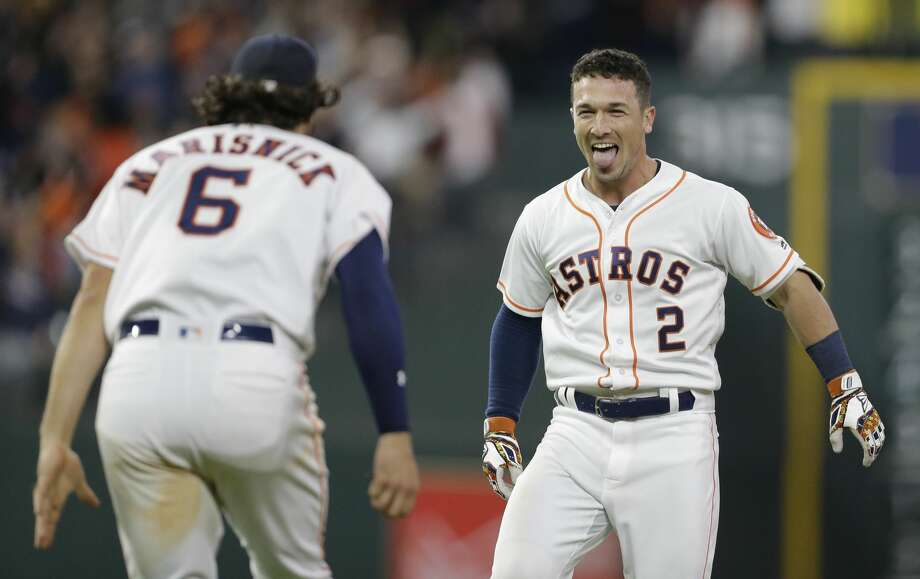 Houston Astros Jake Marisnick and Alex Bregman celebrate Bregman's single hit during the tenth inning to win over the San Diego Padres at Minute Maid Park Saturday, April 7, 2018, in Houston. ( Melissa Phillip / Houston Chronicle ) Photo: Melissa Phillip/Houston Chronicle