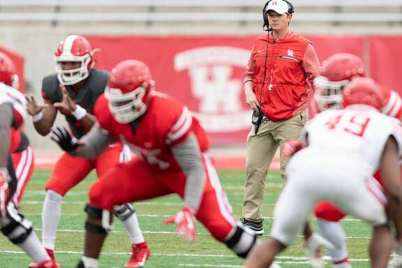 Houston Cougars Head Coach, Major Applewhite watches his team on the field during a University of Houston spring football game on Saturday, April 7, 2018 at TDECU Stadium in Houston Texas.