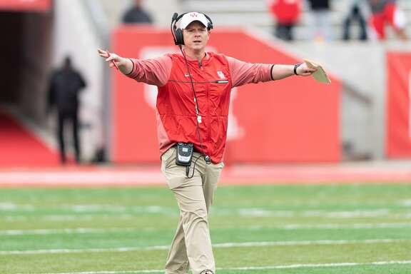 Houston Cougars Head Coach, Major Applewhite, calls for a short rest period after the end of the first quarter in a University of Houston spring football game on Saturday, April 7, 2018 at TDECU Stadium in Houston Texas.