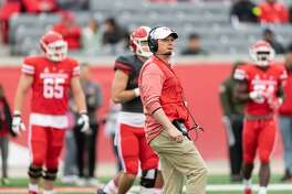 Houston Cougars Head Coach, Major Applewhite watches his team on the field during the spring football game on Saturday, April 7, 2018 at TDECU Stadium in Houston Texas.