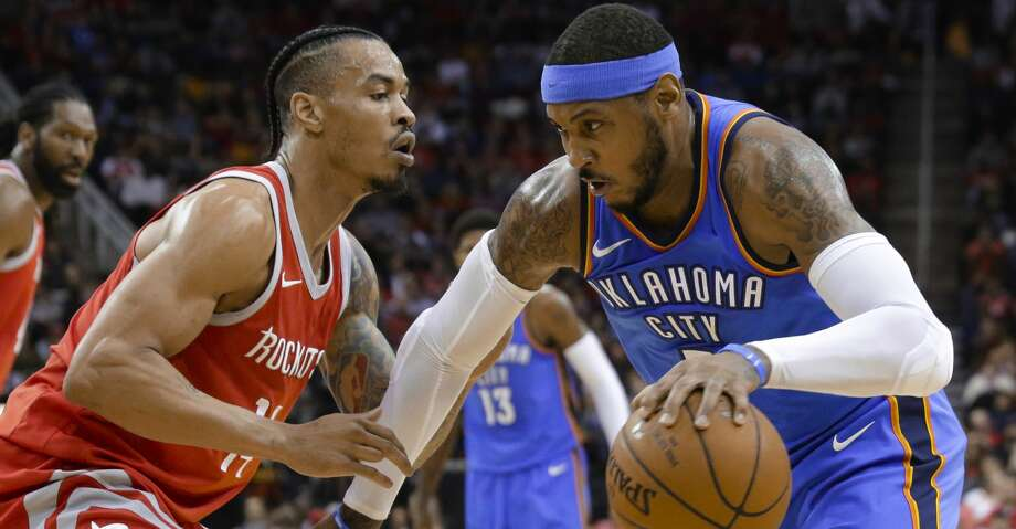 Oklahoma City Thunder forward Carmelo Anthony (7) looks to drive around Houston Rockets guard Gerald Green (14) during the first half of an NBA basketball game Saturday, April 7, 2018, in Houston.  Photo: Michael Wyke/Associated Press