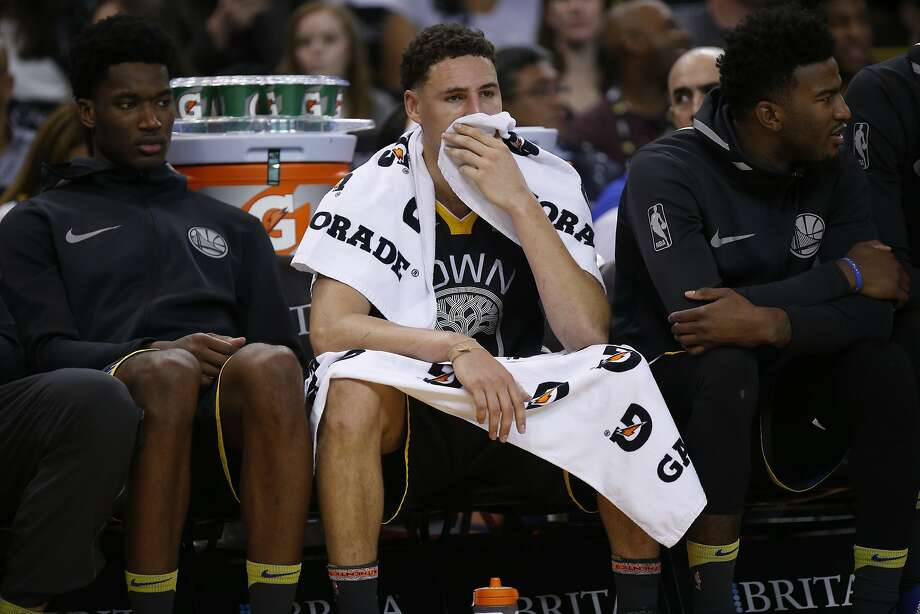 Warriors guard Klay Thompson gets a breather during the second half against the New Orleans Pelicans, which needed to beat Golden State to keep pace to the playoffs — and did, 126-120. Photo: Santiago Mejia / The Chronicle