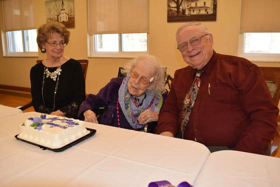 Esta Lou Hubbert, formerly of Winchester, celebrates her 100th birthday Saturday with her daughter-in-law Connie Messamore and son Dean Hubbert of Winchester at Jacksonville Skilled Nursing. Five generations of Hubbert's family showed up to celebrate with her. Hubbert was an English teacher at Winchester Jr. High and North Jacksonville School for many years and now spends her days with family and friends at Jacksonville Skilled Nursing. Photo: Nick Draper | Journal-Courier