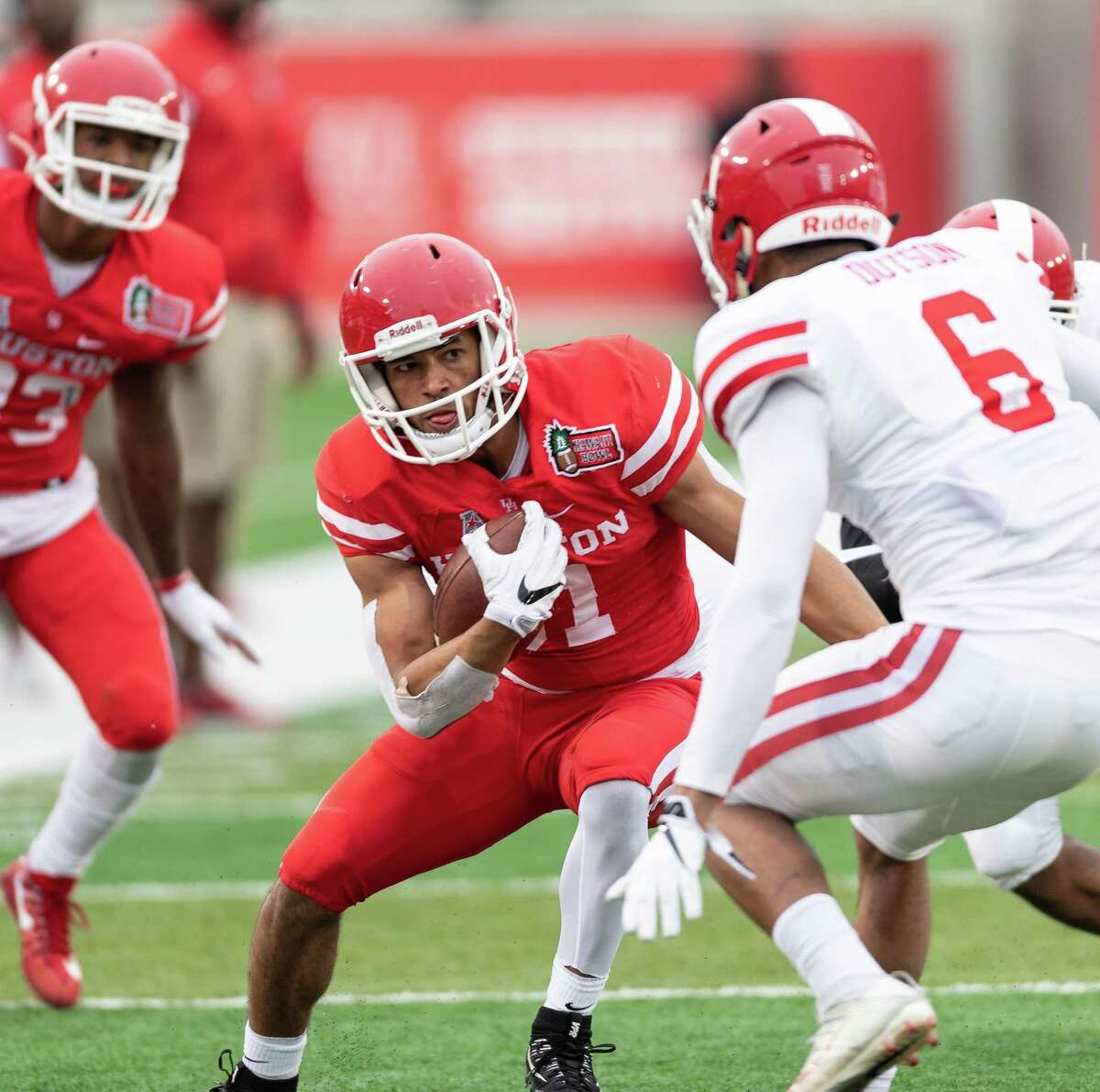UH wide receiver Tre'von Bradley, center, represents a youth movement for coach Major Applewhite's new-look, downfield offensive attack.