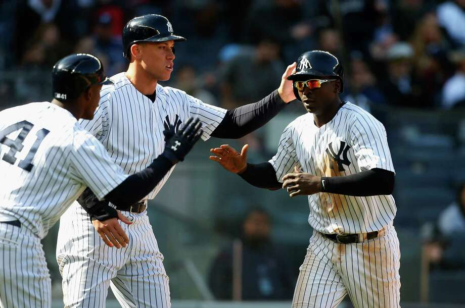 NEW YORK, NY - APRIL 07:  Didi Gregorius #18 and Aaron Judge #99 of the New York Yankees celebrate with teammate Miguel Andujar #41 after both scored in the seventh inning against the Baltimore Orioles at Yankee Stadium on April 7, 2018 in the Bronx borough of New York City.  (Photo by Jim McIsaac/Getty Images) Photo: Jim McIsaac / 2018 Getty Images
