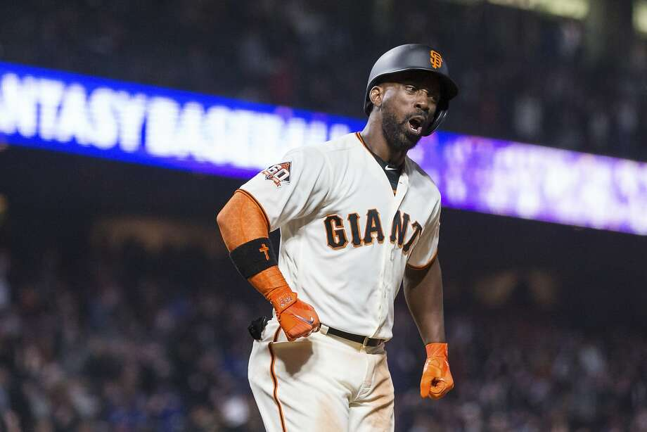 Giants right fielder Andrew McCutchen reacts after hitting a three-run home run — his sixth hit of the game — for a walkoff win over the visiting Dodgers. Photo: John Hefti / Associated Press