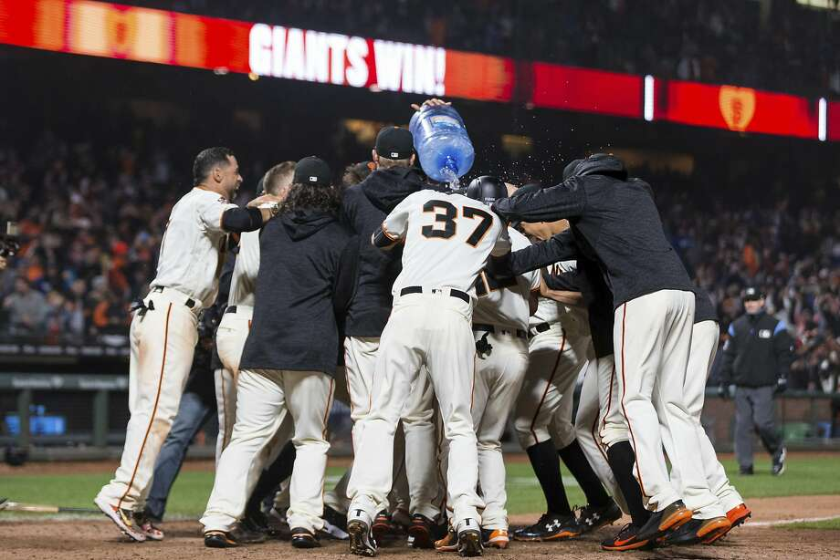 The San Francisco Giants celebrate their win over the Los Angeles Dodgers after 14 innings of a baseball game in San Francisco, Saturday, April 7, 2018. (AP Photo/John Hefti) Photo: John Hefti / Associated Press
