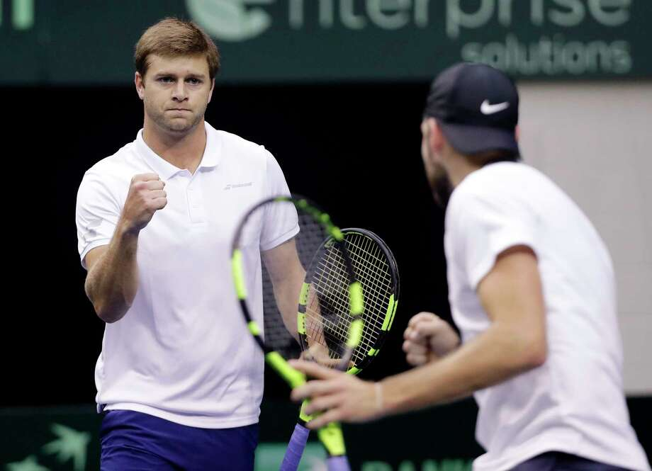 Ryan Harrison, left, of the United States, and Jack Sock celebrate after winning a point during a Davis Cup quarterfinal doubles tennis match against Belgium Saturday, April 7, 2018, in Nashville, Tenn. (AP Photo/Mark Humphrey) Photo: Mark Humphrey / Copyright 2018 The Associated Press. All rights reserved.