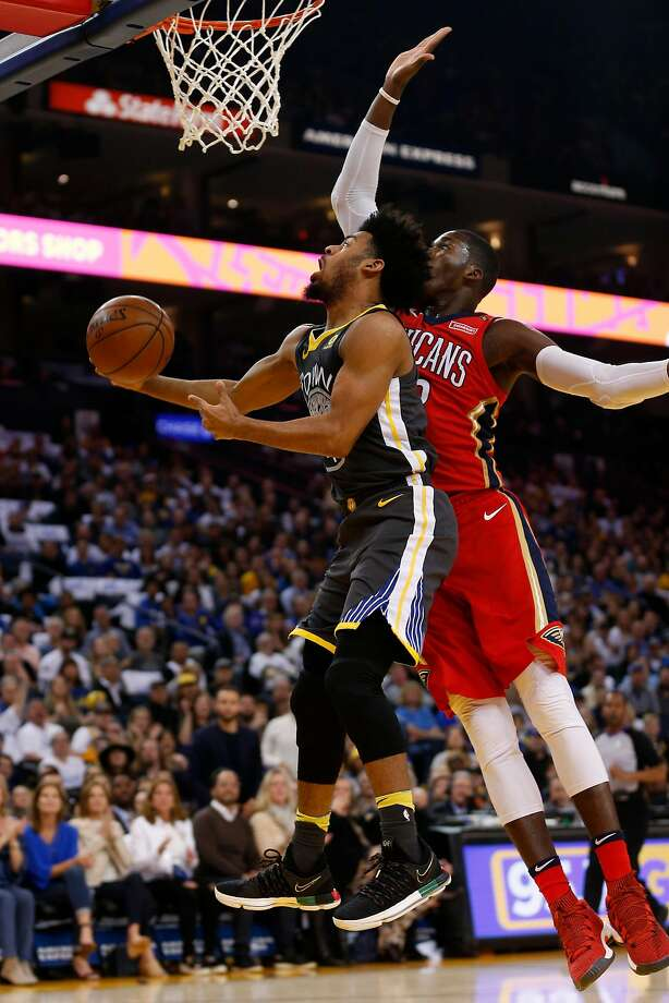 Warriors guard Quinn Cook (left) gets blocked by Pelicans forward Cheick Diallo but scored 21 points, shooting 8 for 14. Photo: Santiago Mejia / The Chronicle