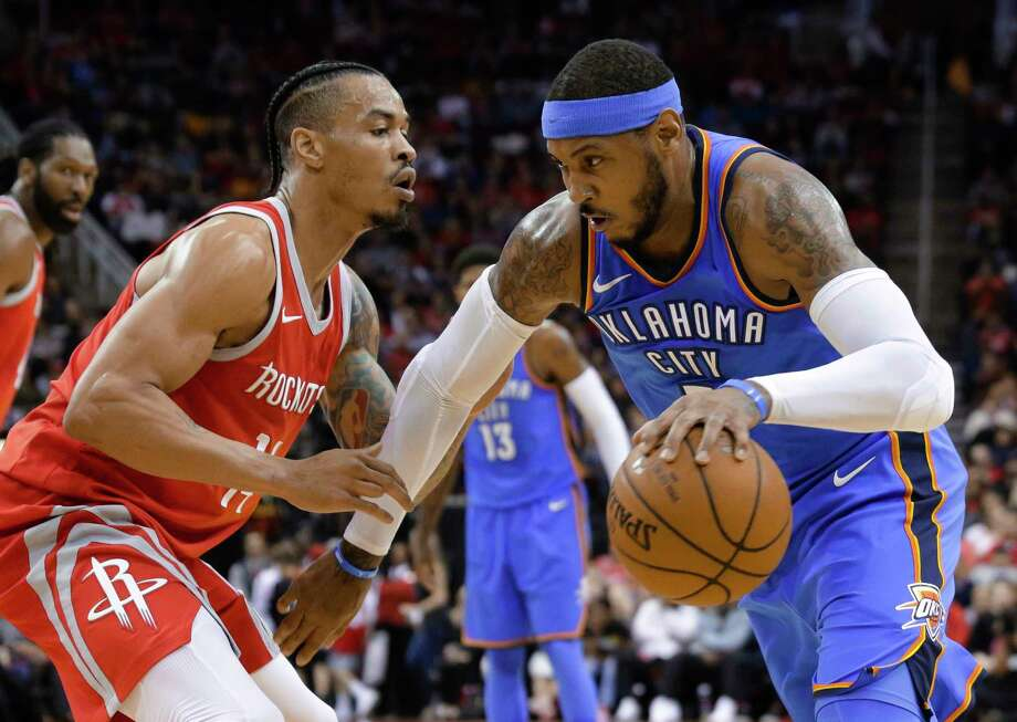 Oklahoma City Thunder forward Carmelo Anthony (7) looks to drive around Houston Rockets guard Gerald Green (14) during the first half of an NBA basketball game Saturday, April 7, 2018, in Houston. (AP Photo/Michael Wyke) Photo: Michael Wyke / © Associated Press 2018
