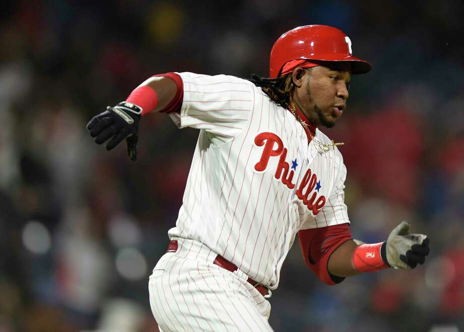 Maikel Franco rounds first base after hitting a double in the fourth inning of a baseball game against the Miami Marlins, Saturday, April 7, 2018, in Philadelphia. (AP Photo/Michael Perez) Photo: Michael Perez / FR168006 AP