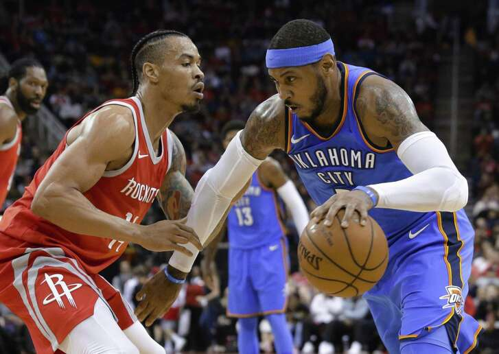 Thunder forward Carmelo Anthony, right, looks to drive around Rockets guard Gerald Green during the first half. Anthony had 22 points and six rebounds.