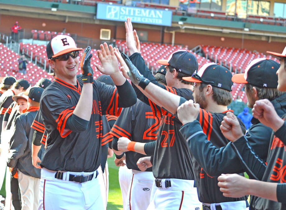 Edwardsville sophomore Matthew Stopka exchanges high fives with teammates during pre-game introductions at Saturday's game against Hillsboro, Mo., at Busch Stadium.