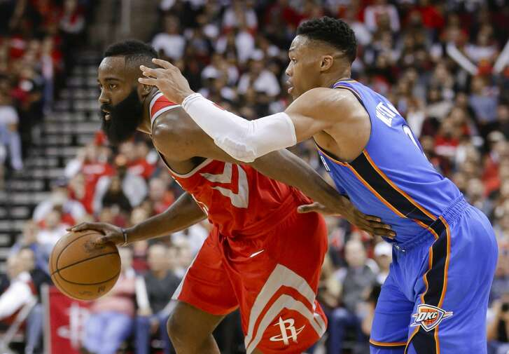 Houston Rockets guard James Harden (13) looks to pass the ball under pressure from Oklahoma City Thunder guard Russell Westbrook (0) during the second half of an NBA basketball game Saturday, April 7, 2018, in Houston. (AP Photo/Michael Wyke)