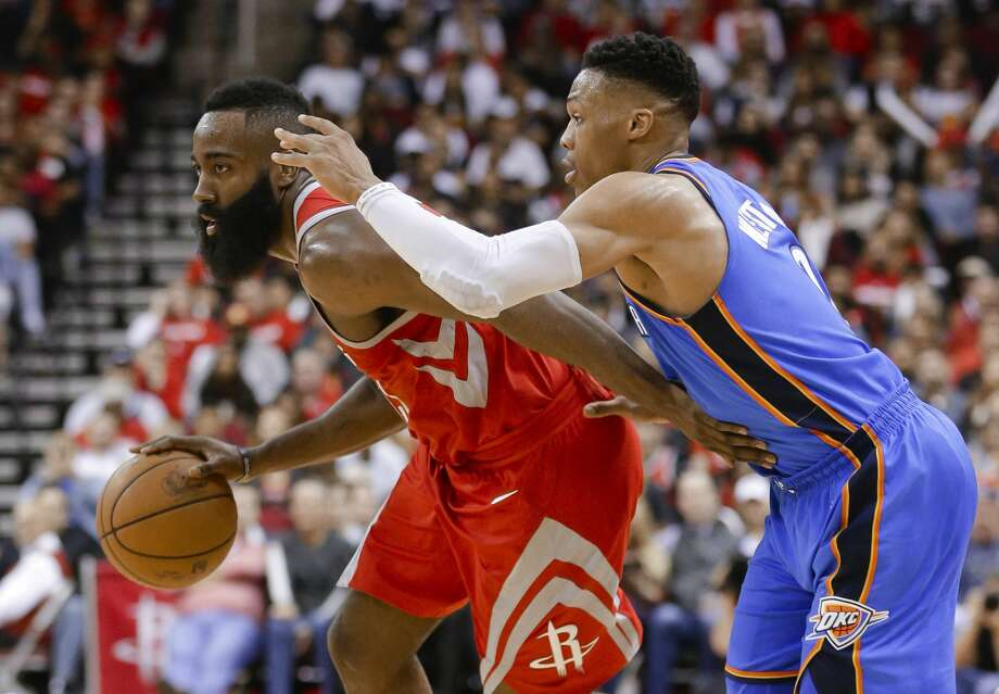 Houston Rockets guard James Harden (13) looks to pass the ball under pressure from Oklahoma City Thunder guard Russell Westbrook (0) during the second half of an NBA basketball game Saturday, April 7, 2018, in Houston. (AP Photo/Michael Wyke) Photo: Michael Wyke/Associated Press
