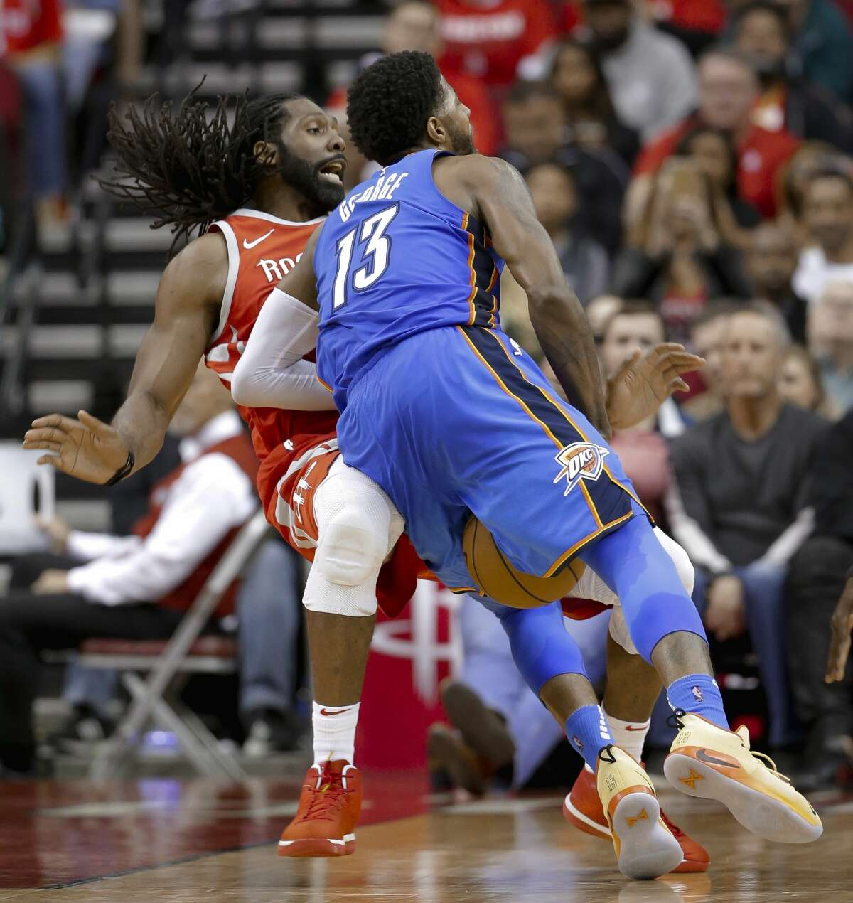 Oklahoma City Thunder forward Paul George (13) drives into Houston Rockets center Nene (42) and is called for an offensive foul during the second half of an NBA basketball game Saturday, April 7, 2018, in Houston. (AP Photo/Michael Wyke)