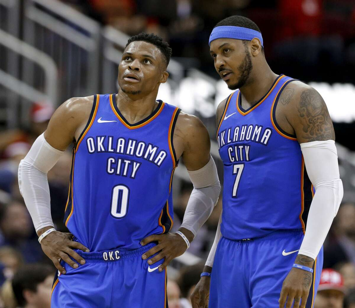 Oklahoma City Thunder guard Russell Westbrook (0) and forward Carmelo Anthony (7) talk during the second half of the team's NBA basketball game against the Houston Rockets on Saturday, April 7, 2018, in Houston. (AP Photo/Michael Wyke)