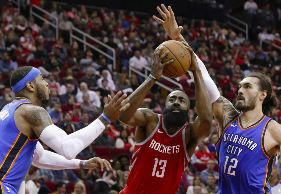 Houston Rockets guard James Harden (13) drives for a shot between Oklahoma City Thunder forward Carmelo Anthony, left, and center Steven Adams (12) during the second half of an NBA basketball game Saturday, April 7, 2018, in Houston. (AP Photo/Michael Wyke) Photo: Michael Wyke/Associated Press