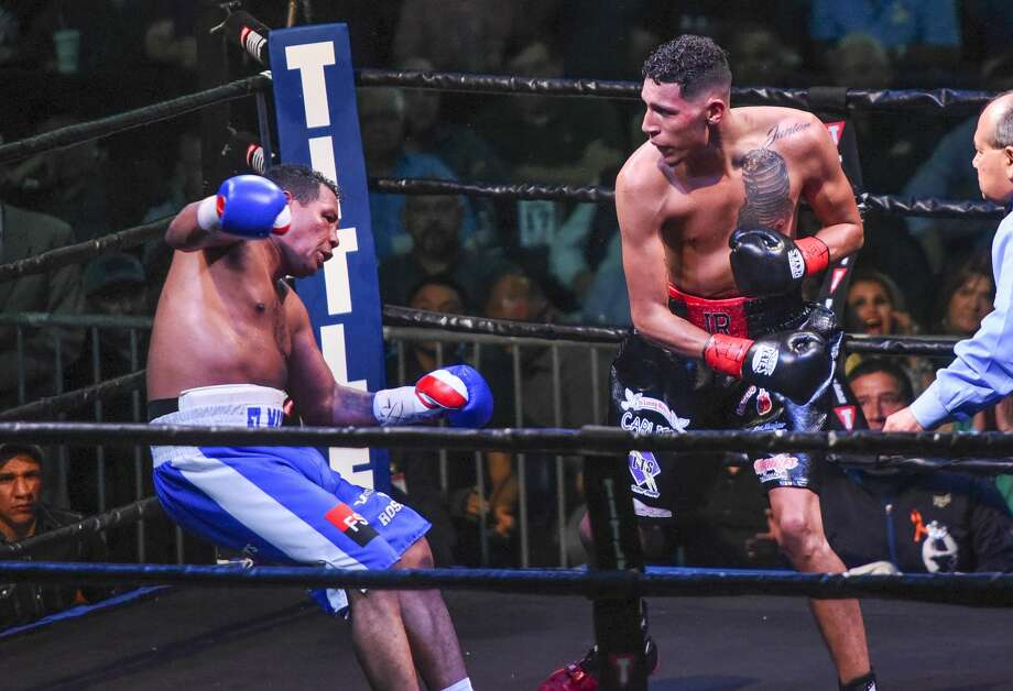 Rodolfo Gomez, black trunks, goes up against Ricardo Mayorga on Saturday, Apr. 7, 2018 at the Laredo Energy Arena during the Battle of the Borderland 1 boxing matches. Photo: Danny Zaragoza/Laredo Morning Times