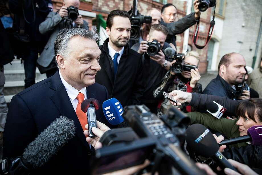 Viktor Orban, Hungary's prime minister, speaks to reporters after casting his ballot at a polling station in Budapest. Photo: Akos Stiller / Bloomberg News