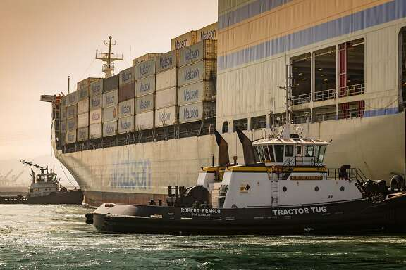 Tugboats guide the Matson Inc. Mokihana cargo ship into the Port of Long Beach in Long Beach, California, U.S., on Wednesday, April 4, 2018. The U.S.�trade deficit�widened by more than forecast to a fresh nine-year high in February amid broad-based demand for imports, ahead of Trump administration tariffs that have raised the specter of a trade war. Photographer: Tim Rue/Bloomberg