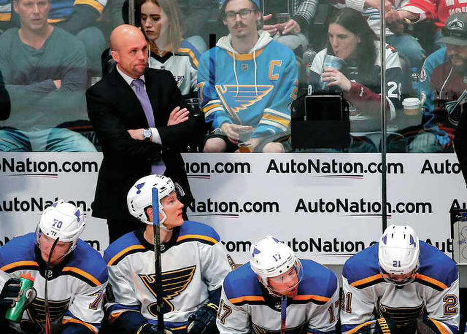 Blues coach Mike Yeo watches during the third period of the team's game against the Colorado Avalanche on Saturday night in Denver. Colorado won 5-2 to advance to the playoffs, while the loss denied the Blues a postseason appearance. Photo: Associated Press