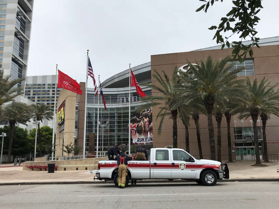 Houston firefighters load up fans after clearing out smoke that came from a small fire in a storage area at the Toyota Center on Sunday, April 8, 2018.  (Elizabeth Conley/Houston Chronicle) Photo: (Elizabeth Conley/Houston Chronicle)