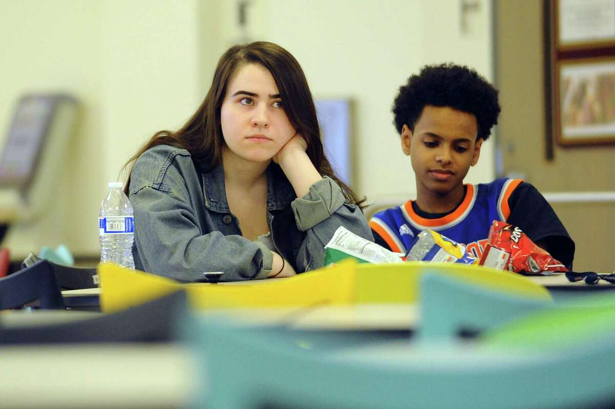AITE senior Bridget Iadanza, 17, listens to a presentation by the Center for Sexual Assault Prevention and Education inside the school cafeteria in Stamford, Conn. on Thursday, April 5, 2018. The presentation, given to students in the Mayor's Youth Leadership Council, covered important topics like consent and the dynamics of sexual assault as well as debunking myths about perpetrators and victims.