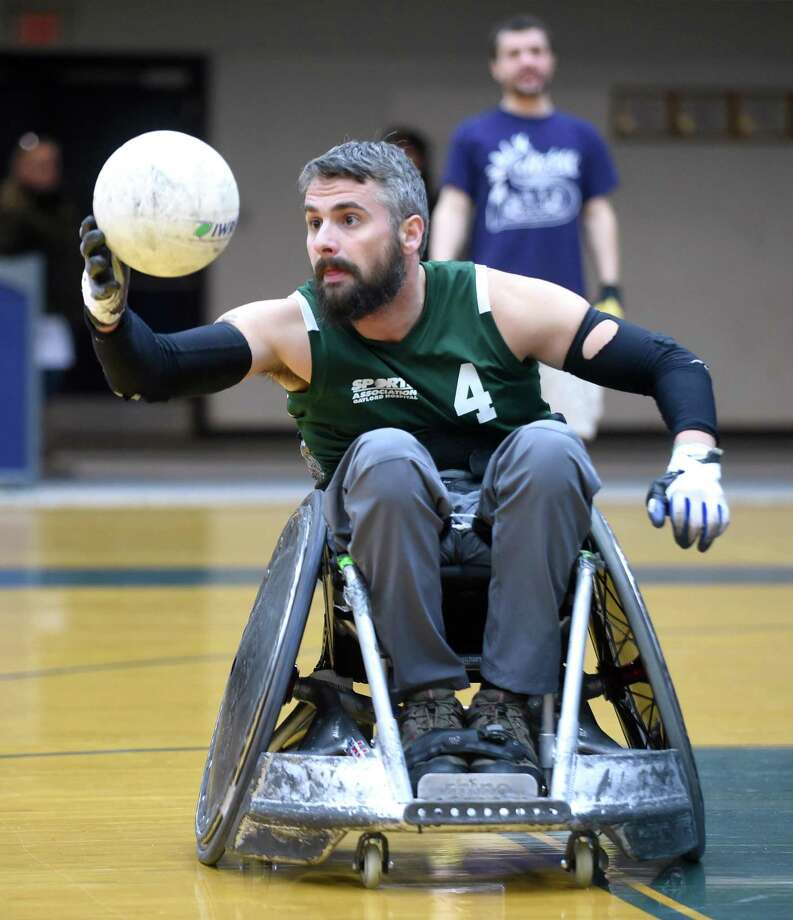 Brett Smith of the Connecticut Jammers Quad Rugby Team catches a pass during a wheelchair rugby demonstration and clinic at the Adaptive Sports Fest at Southern Connecticut State University's Moore Field House in New Haven on Saturday. Photo: Arnold Gold / Hearst Connecticut Media / New Haven Register