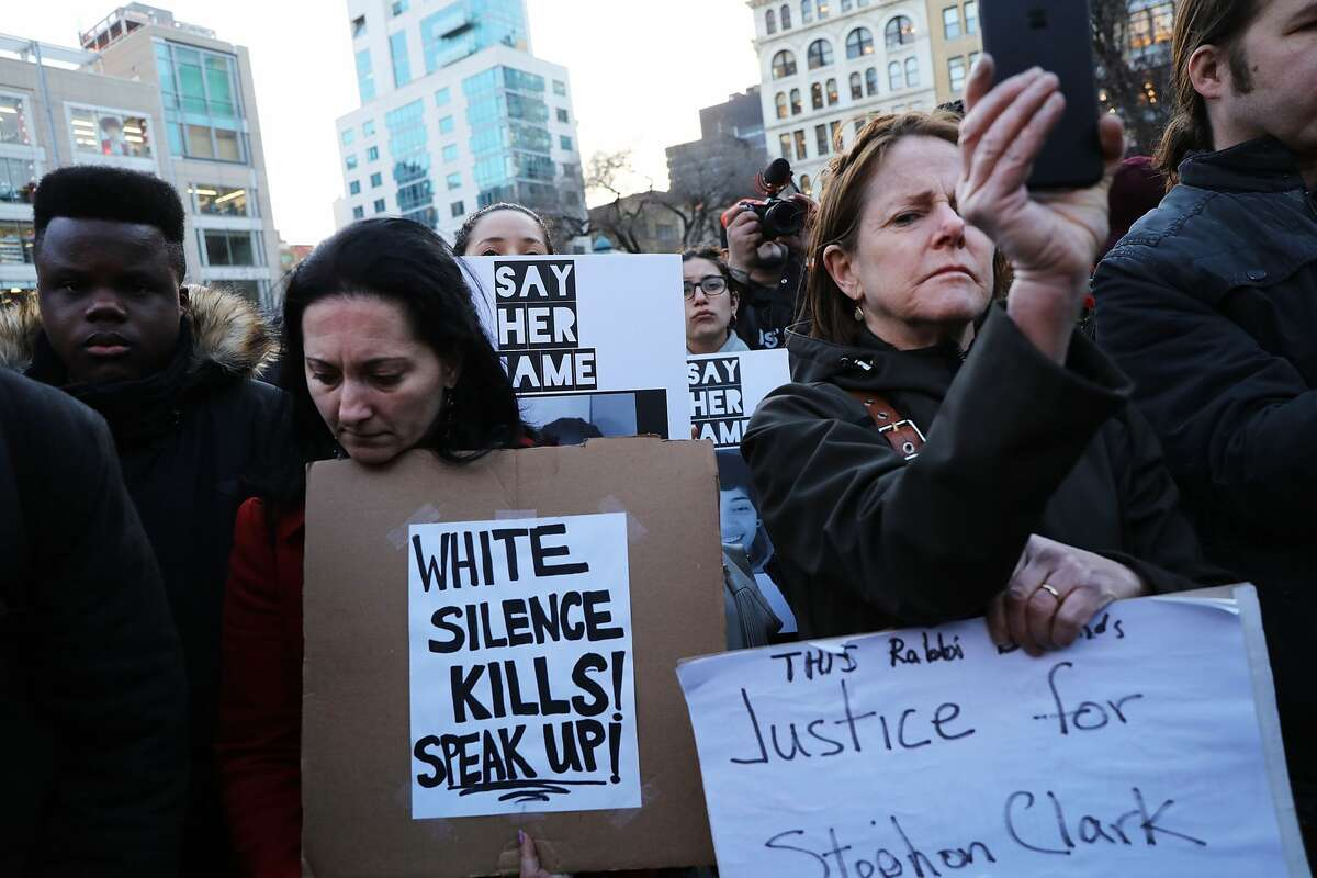 People attend a vigil for Stephon Clark, the young black man killed by police in Sacramento, on the anniversary of the assassination of Dr. Martin Luther King on April 4, 2018 in New York City. Tensions have flared in Sacramento and across the nation after an independent autopsy revealed that police officers shot Clark at least seven times in the back on March 18 while responding to reports of someone smashing car windows in his neighborhood. (Photo by Spencer Platt/Getty Images)