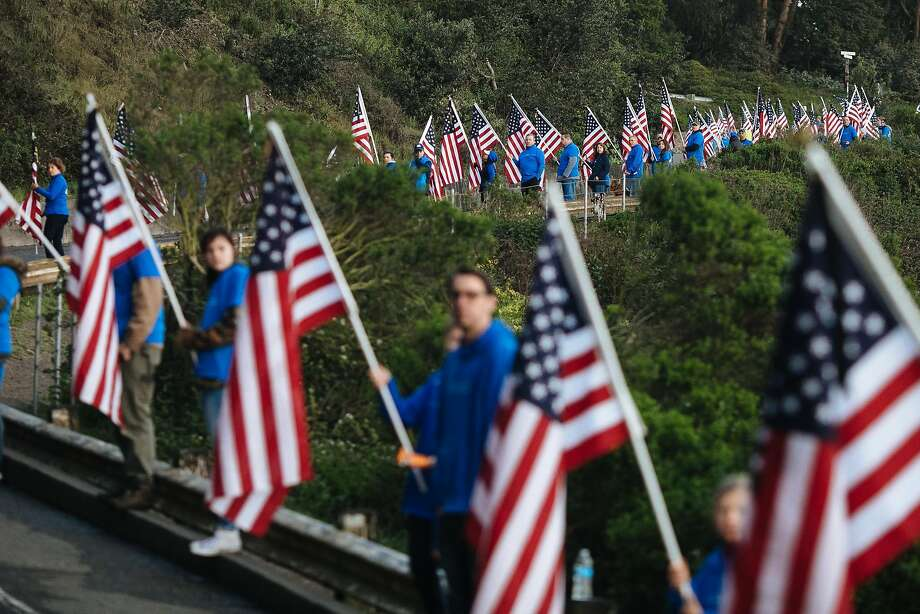 American flag-bearers wait for the runners on Crissy Field Avenue during the Rock 'n Roll Half Marathon in San Francisco on April 8. Photo: Mason Trinca / Special To The Chronicle