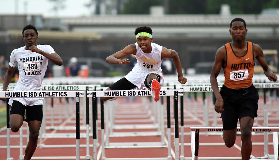 Fort Bend Marshall sophomore Dominick Houston-Shepard, center, pushes to the finish line against Port Arthur Memorial senior Bryan Moore, left, and Hutto junior De'Vion Wilson, right, during the Men's 110 Meter Hurdles at the UIL Region III-5A Track Meet at Turner Stadium on April 29, 2017. (Photo by Jerry Baker/Freelance) Photo: Jerry Baker, Freelance / Freelance