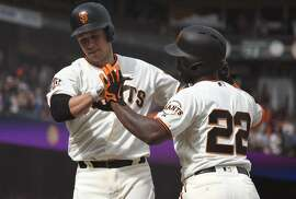 SAN FRANCISCO, CA - APRIL 07:  Buster Posey #28 and Andrew McCutchen #22 of the San Francisco Giants celebrates after Posey hit a two-run homer against the Los Angeles Dodgers in the bottom of the fourth inning of a Major League Baseball game at AT&T Park on April 7, 2018 in San Francisco, California.  (Photo by Thearon W. Henderson/Getty Images)