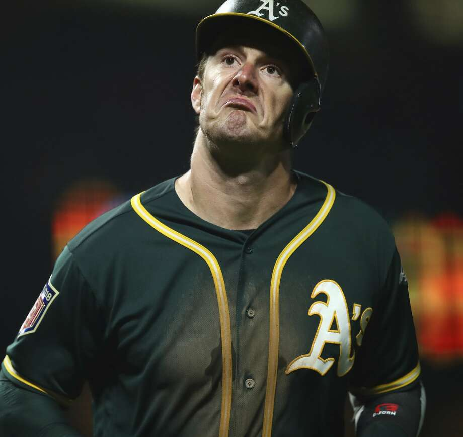Oakland Athletics' Mark Canha reacts after hitting a home run off San Francisco Giants' Derek Holland during the fifth inning of a spring training baseball game on Monday, March 26, 2018 in San Francisco. (AP Photo/Ben Margot) Photo: Ben Margot / Associated Press