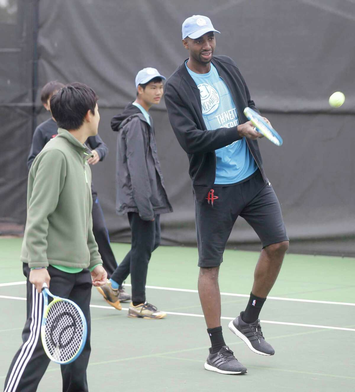 Houston Rockets player Luc Mbah a Moute participates at the Kids Day event during the U.S. Men's Clay Court Championship at River Oaks Country Club, 1600 River Oaks Blvd., Sunday, April 8, 2018, in Houston.
