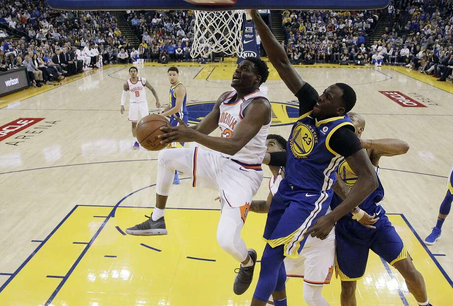 Phoenix Suns' Danuel House Jr., front left, drives past Golden State Warriors' Draymond Green (23) during the first half of an NBA basketball game Sunday, April 1, 2018, in Oakland, Calif. (AP Photo/Marcio Jose Sanchez) Photo: Marcio Jose Sanchez / Associated Press