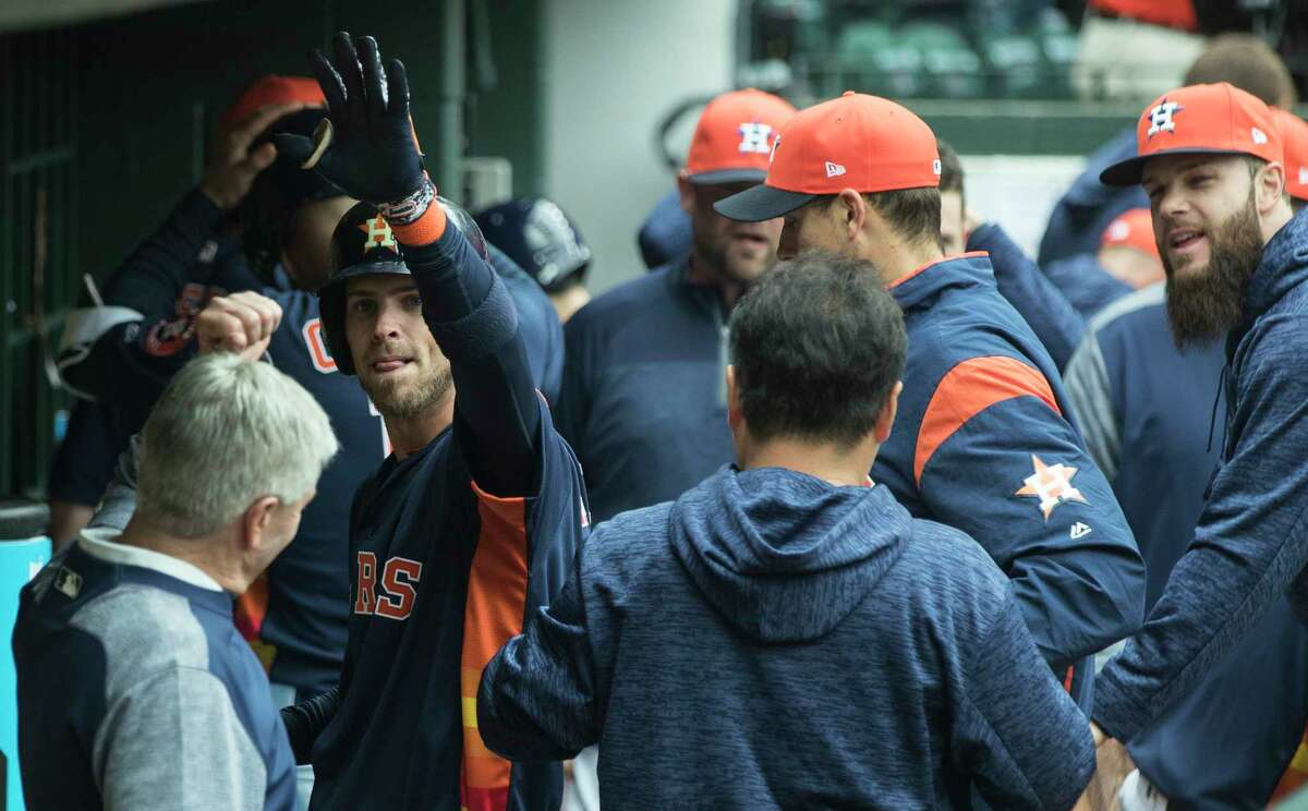 Houston Astros right fielder Josh Reddick (22) high fives his teammates as he reaches the dugout after hitting a solo home run off San Diego Padres starting pitcher Tyson Ross during the sixth inning of a major league baseball game at Minute Maid Park on Sunday, April 8, 2018, in Houston.