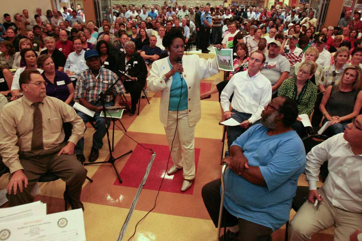 Congress woman Sheila Jackson Lee talks to a full crowd during a town hall style meeting on health care reform at the Northeast Multi-Service Center, Wednesday, August 12, 2009.